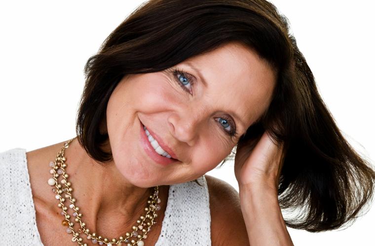 Older woman with short dark hair smiling