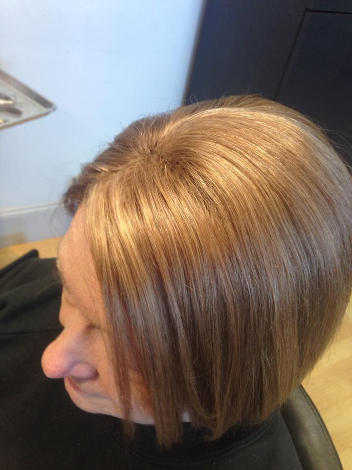 Woman after receiving evolve hair solution treatment