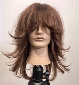 Mannequin with a shag haircut ends are styled outwards