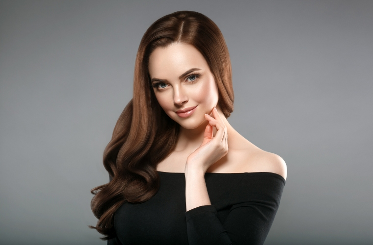 Woman with brown hair posing for picture