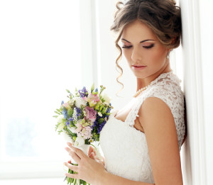 Bride posing with an updo