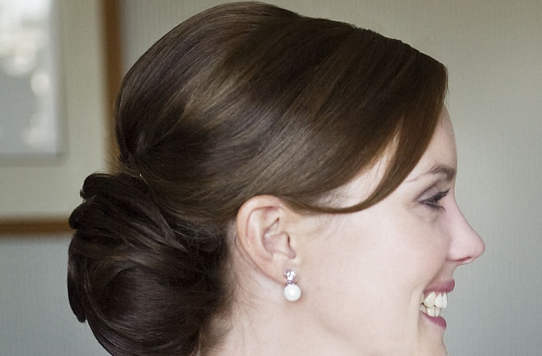 woman with pretty updo facing the right and smiling