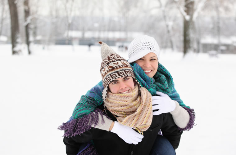 Couple posing together in the snow